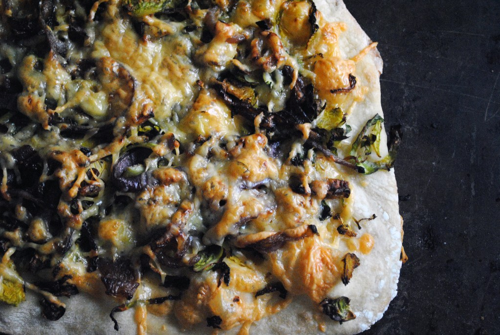 Brussels Sprouts, Smoked Good, and Caramelized Red Onion Pizza